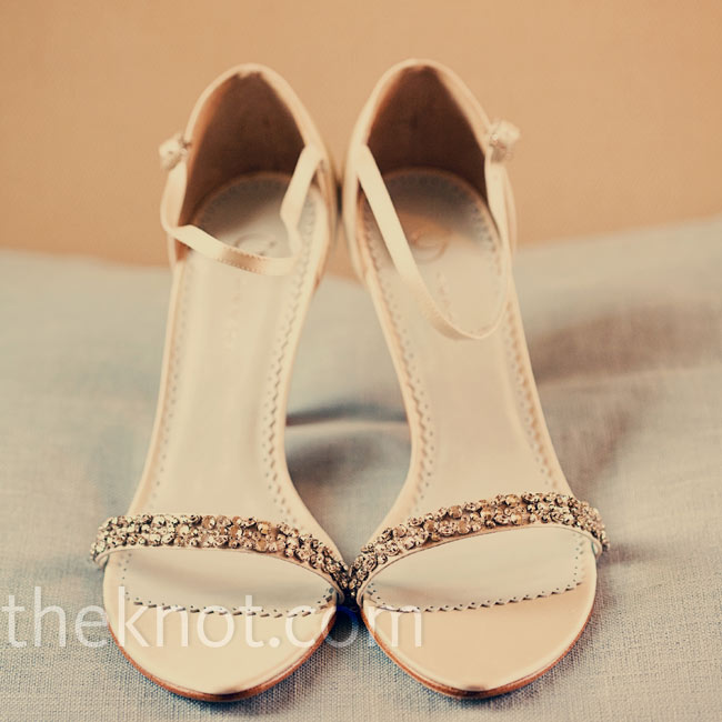 Before changing into a pair of ballet flats for dancing, the bride wore three-inch heels. A thin row of crystals gave the sandals just enough sparkle.