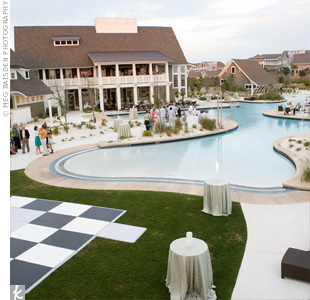Guests mingled around a pool at the laid-back outdoor reception. Instead of a plated dinner, guests picked up their food from four themed stations.