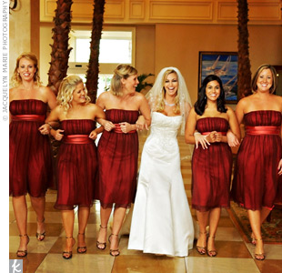 The five bridesmaids wore knee-length chiffon dresses in burgundy. Jodie adored the color and thought the style was a good match for the wedding's modern, romantic vibe.