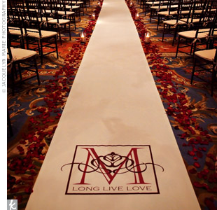 A runner with the couple's monogram personalized the ceremony space.
