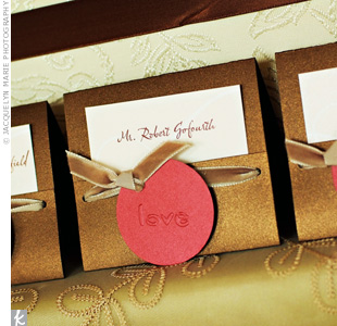 "Inserts with guests' names printed on them were tucked into tented cards. Round tags with the word ""love"" on them gave the cards a polished look."