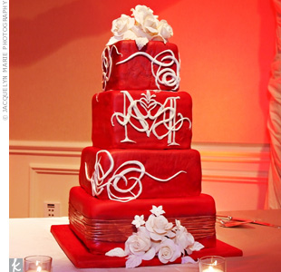 At first, the nontraditional couple planned to skip the cake, but it ended up being more cost-effective to have one! They chose a four-tiered dessert with their monogram on it.