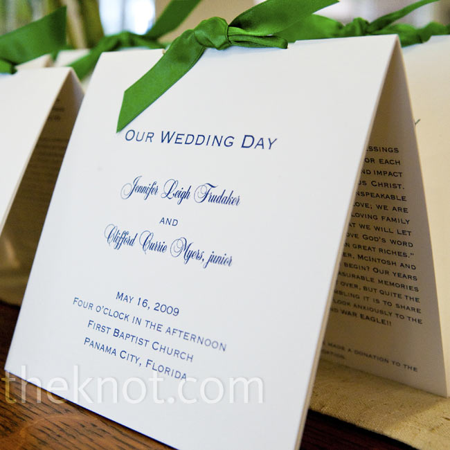 Guests grabbed tented programs from a table near the ceremony entrance. Navy text and green ribbons worked in both hues of the color scheme.