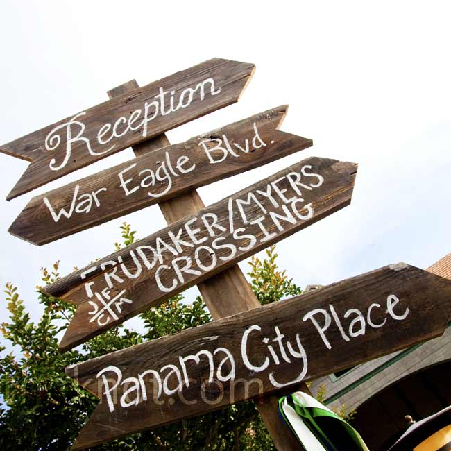 A rustic signpost at the reception site pointed guests in the right direction and personalized the space.