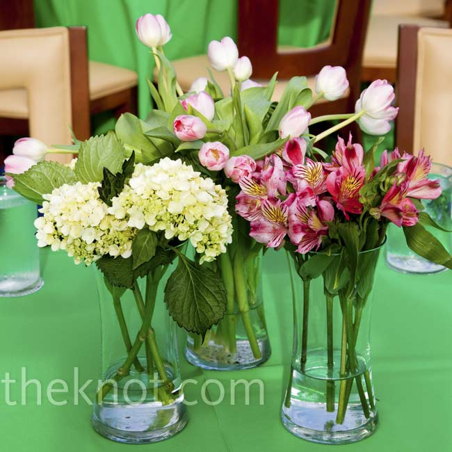 To contrast with the elaborate seven-foot-tall arrangements on some tables, others had simple groupings of hydrangeas, tulips, and alstroemeria.