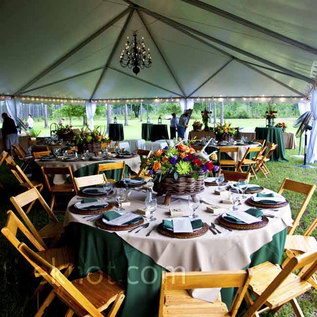 The couple chose a preppy chic color scheme of kelly-green and navy. Country-Western elements, like hay and antler decorations, kept the garden party relaxed.