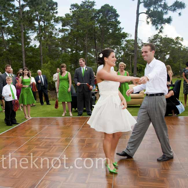 "The newlyweds did a fun swing dance to the song ""A Wink and a Smile,"" by Harry Connick Jr."