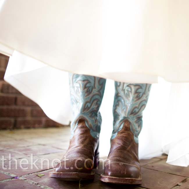 The bride wore her favorite cowboy boots for the horse-drawn carriage ride to the ceremony. She exchanged the colorful boots for stilettos right before her walk down the aisle.
