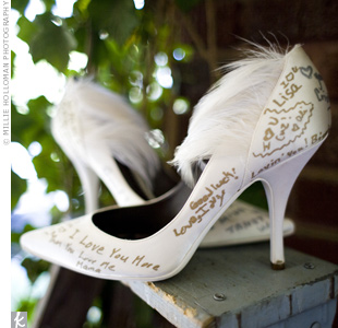 The bride's Vouelle shoes (her favorites!) were shipped in from Paris. She had them signed by guests at her bridesmaids luncheon and put on display in the church foyer before the ceremony.