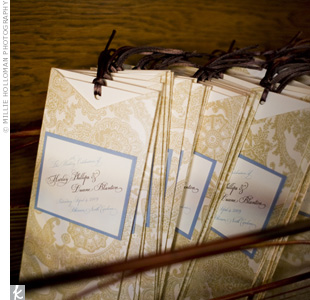 The groom's sons distributed the brown-and white paisley-patterned, pocket-style programs. A deep brown ribbon and French-blue and ivory label tied into the colors of the day.