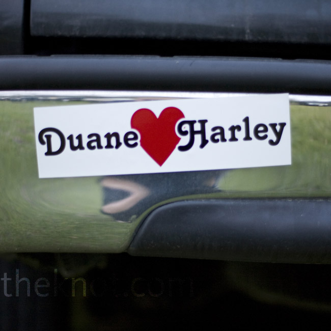While guests enjoyed the ceremony, the couple had friends decorate their vehicles with magnetic bumper stickers.