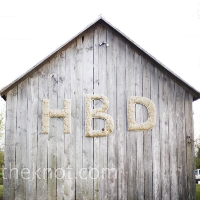 The reception was held in the back yard of Harley's grandparents' farm where she grew up. The couple's new monogram hung on the side of the barn.