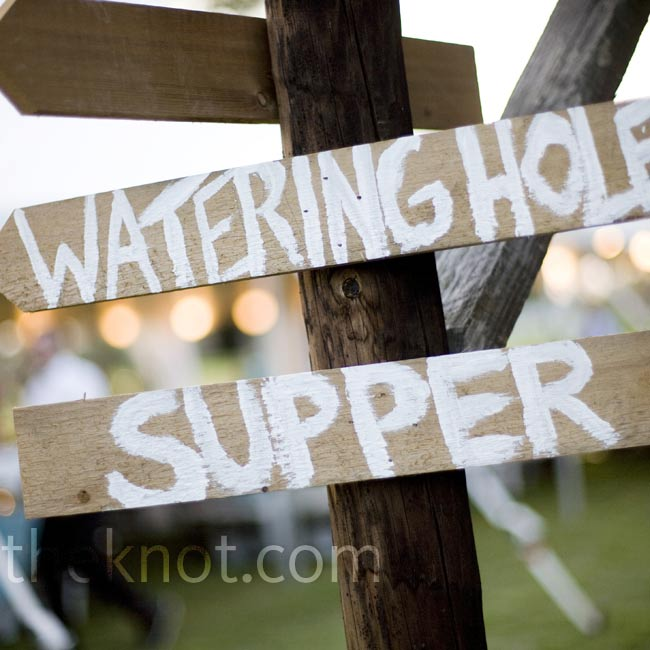 "A wooden signpost pointed guests toward ""supper"" and the ""watering hole"" from painted arrows, nailed to the side of the barn."