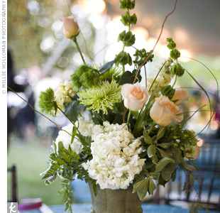 Each table featured a moss-covered urn filled with hydrangeas, snapdragons, bells of Ireland, curly willow, spider mums, and pheasant feathers.