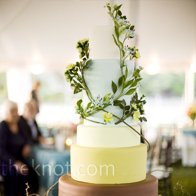Based on the wedding's color scheme and theme, the bakers created a beautiful five-tiered fondant-covered cake representing the ascent from the pale blue sky to the brown earth.