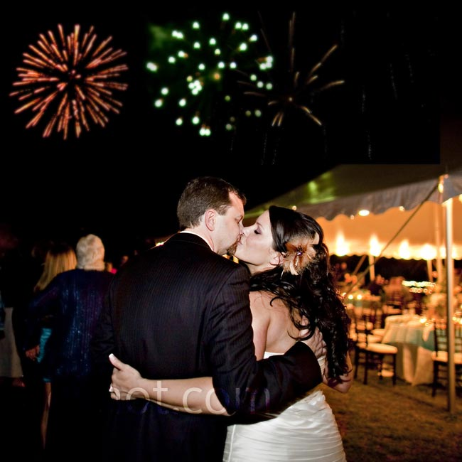 Harley and Duane stole a kiss as a grand fireworks display lit the night sky during the reception.