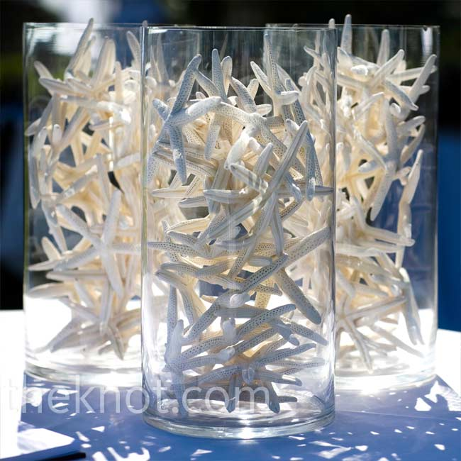 Clusters of tall glass cylinders filled with white starfish continued the beachside ambience beneath the reception tent.