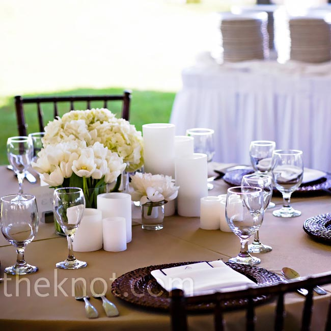Taupe table linens, rattan chargers, and white napkins topped the tables.
