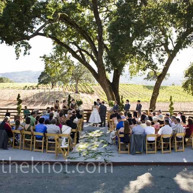 Alexis and Sean's ceremony was held on a raised platform, giving guests a better view of the surrounding oak trees, vineyard, and rolling hills.