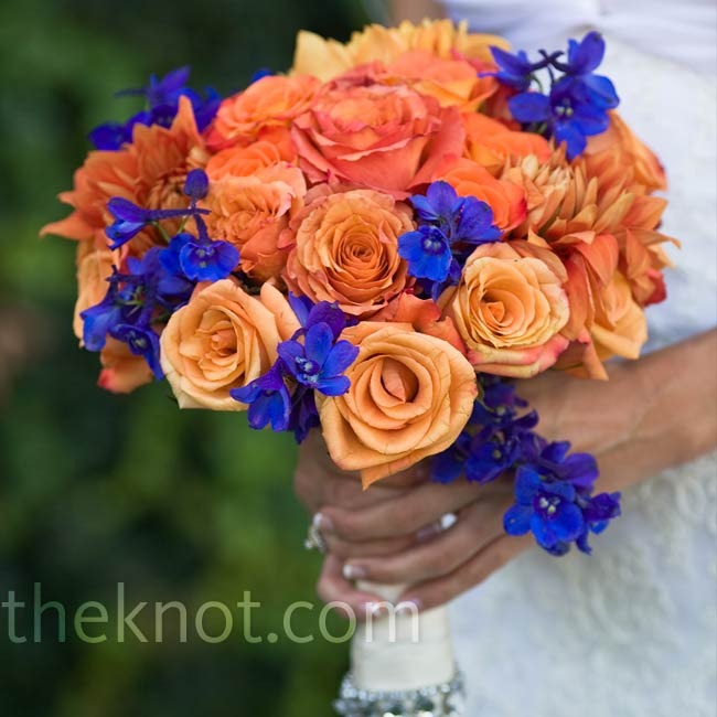 Blue delphiniums popped against three types of orange roses. For extra glamour, the stems were wrapped in satin adorned with rhinestones.
