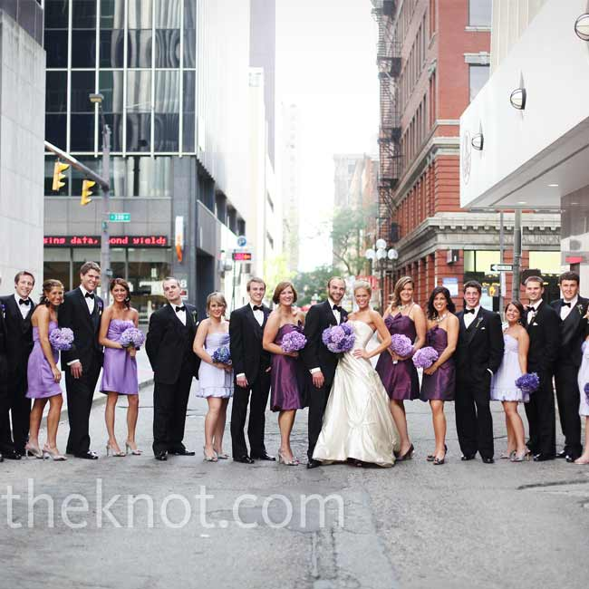Abby wanted something elegant yet trendy for her bridesmaids, so she decided to go with three different styles and shades of purple. The guys wore classic black tuxes.