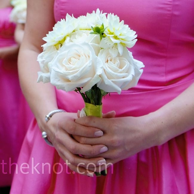 The bridesmaids carried monochromatic bouquets of ivory blooms, like mums and roses, so they would stand out against the backdrop of the watermelon-colored gowns.