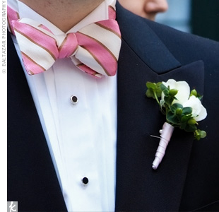 Small garden roses and hypericum berries adorned the groom's lapel.