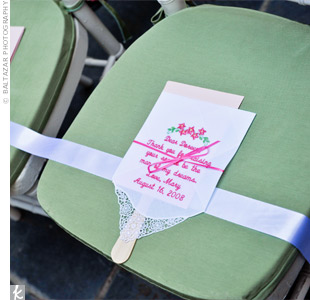 "Mary and Trevor placed a pink-and-green, fan-shaped program on each guest's chair. ""They were simple and practical,"" says Mary."