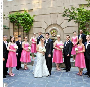 The bridesmaids' wore bright watermelon-colored knee-length dresses in their favorite styles. Trevor and his groomsmen wore tuxedos and custom made pink-and-white bowties.