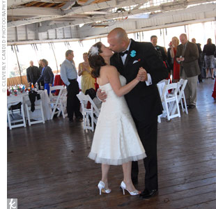"The bride, an avid swing dancer, chose her favorite swing band, Blue Sky 5, to perform the first dance song, ""A Kiss to Build a Dream On."""