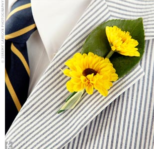 To match Robyn's bouquet, Jordan and his groomsmen each wore two mini sunflowers on their lapels.