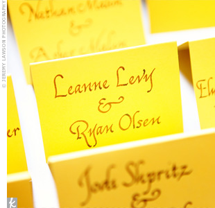 The couple's calligrapher wrote guests' names and table numbers in a casual font, fitting the laid-back wedding vibe.