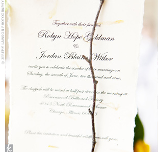 To go with their sunflower theme, the couple's invites were printed on cotton fiber paper embedded with flower seeds. Guests could plant them after the wedding.