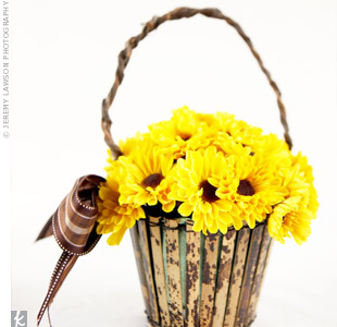 The flower girl carried sunflowers, of course, in a faded-wood basket decorated with brown ribbon.