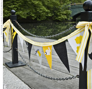 The bride and her creative friends made pennant flags to customize the space along the water. The whimsical designs included birds and bunnies.
