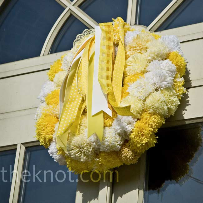 The signature yellow color was everywhere, including in pom-pom wreaths on the doors of the venue.