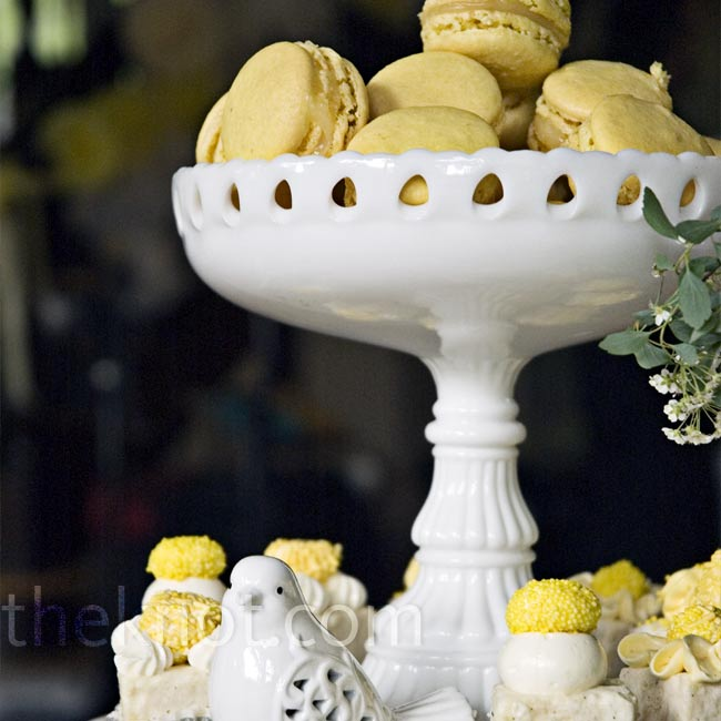 Guests sampled macarons and petits fours that fit the wedding palette. Milk-glass stands for the treats pushed the vintage vibe.