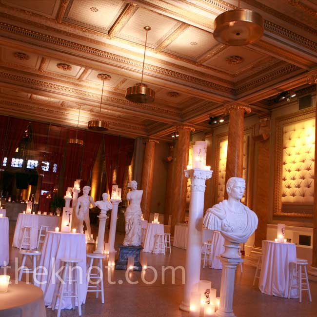 Statues, columns, and candleholders with images of sculptures on them transformed the cocktail hour space into a Greek gallery.