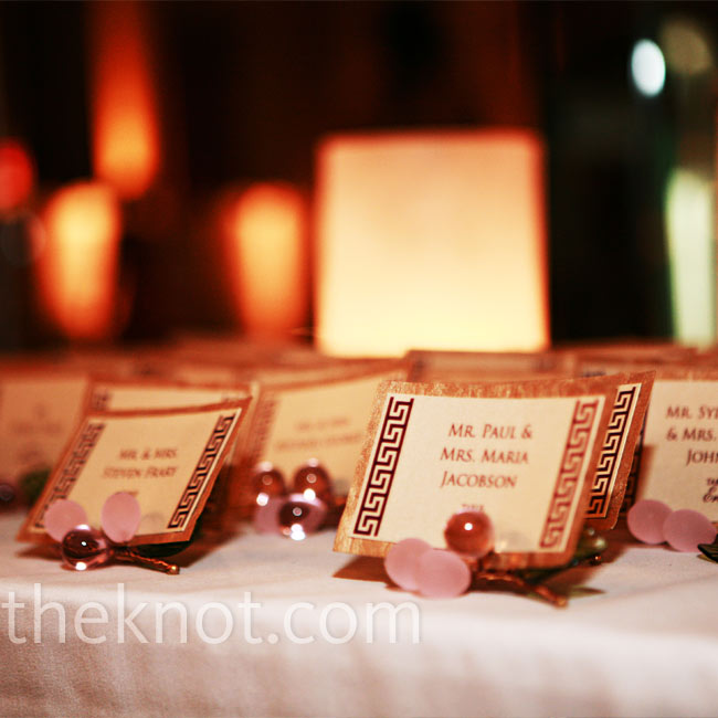 To nod to the theme, a Greek key motif lined the edges of the escort cards while glass grape clusters worked in the signature colors.