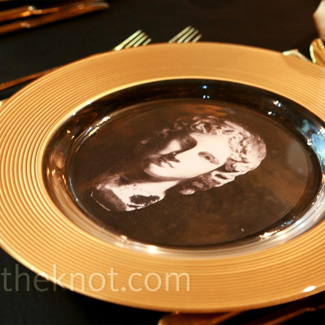 Each gold-rimmed charger was clear in the center so an image of a Greek god or goddess would show through.