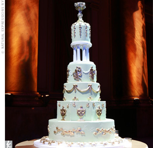 An edible chalice put the finishing touch on the couple's ultra-luxe cake with Grecian filigree designs and a tier of columns for extra height.