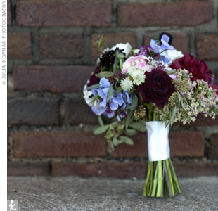 Marni carried a loose mix of roses, ranunculus, peonies, scabiosa, sweet peas, and seeded eucalyptus.