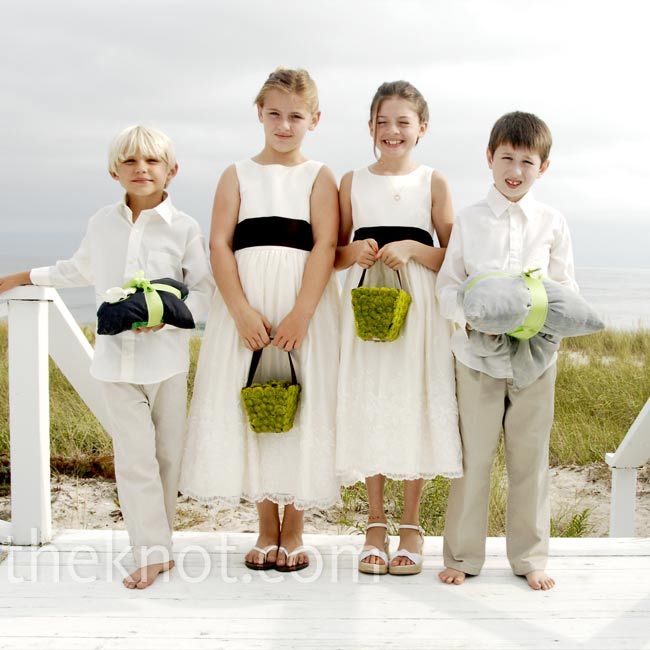 Fitting for a beach wedding, the flower girls wore white sandals, while the ring bearers went barefoot.