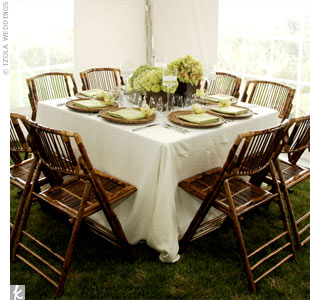 Brown vases, matching the chairs and chargers, held clusters of cymbidium orchids, hydrangeas, spider mums, parrot tulips and roses.