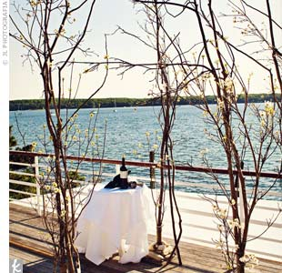 Branches with dogwood blooms made for a huppah that allowed guests to still see the water behind the spot where the couple exchanged vows.