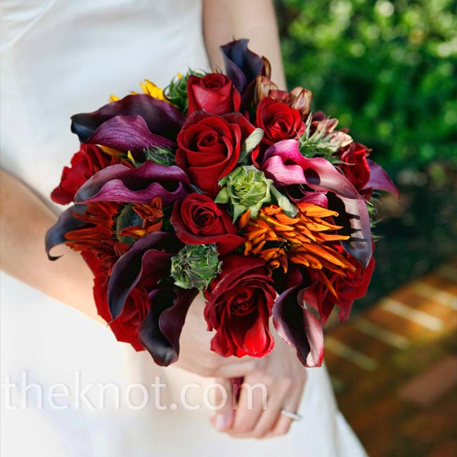 Since the flowers would be out in the sun all day, the bride chose hardy blooms, like roses, calla lilies and sunflowers, for her bouquet.