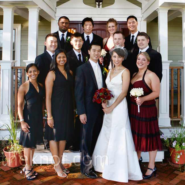 The groomsmen and bridesmen all wore single-button tuxedos. The bridesmaids, who wore burgundy, stood out from the groomswomen, who wore black to match the tuxes.
