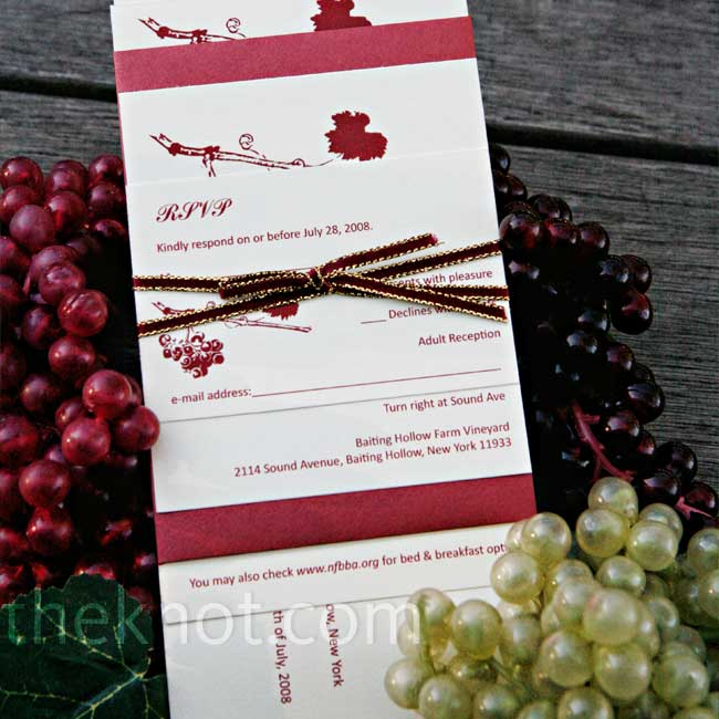 A grapevine motif suited the vineyard setting. Guests also got a glimpse of the wedding's rich color palette.