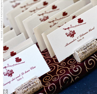 The days signature grapevine graphic decorated the escort cards, which were wedged into wine corks for a vineyard twist.