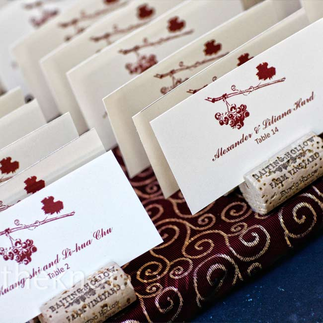 The day's signature grapevine graphic decorated the escort cards, which were wedged into wine corks for a vineyard twist.